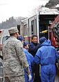 110315-F-YC711-121 instructing Fukushima firefighters on how to operate American fire engine.jpg