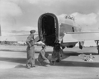 No. 115 Squadron RAF - Crewmembers inspect tail of 115 Squadron Lancaster Mark II which had its rear turret sheared off by bombs dropped from above during a raid on Cologne, June 1943