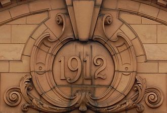 1912 date-mark on the apex of a building at Springfield, Birmingham, England. 1912-detail-Springfield-Birmingham.jpg