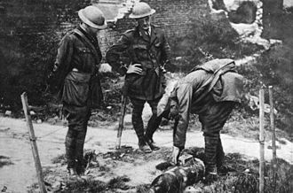 Bomb disposal - A British NCO prepares to dispose of an unexploded bomb, during the First World War.