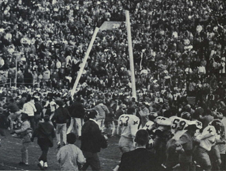 1964 Michigan Wolverines football team - Michigan fans tear down the goal posts after a victory in the 1965 Rose Bowl.