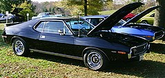 "shows a factory original 1973 Javelin AMX finished in black with a 401 ""Go Pac"""
