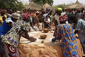 Kaya, Burkina Faso - Women in Kaya kneading millet to prepare food. 2007