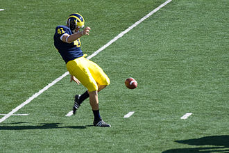 Punter (football) - Zoltán Meskó punting for the 2008 Michigan Wolverines football team.