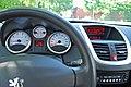 2010 Peugeot 207 Urban Move white 2dr interior dashboard.jpg