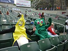 Two people dressed in fancy costume (Gumby - right; Banana – left