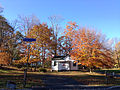 2014-11-02 14 22 13 Old schoolhouse and trees during autumn at the intersection of Poor Farm Road and Woosamonsa Road in Hopewell Township, New Jersey.jpg