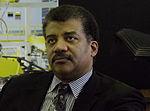 2014 Dr. Neil deGrasse Tyson Visits NASA Goddard (14153427848) (cropped to shoulders).jpg