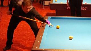 Three-cushion billiards discipline of carom billiards