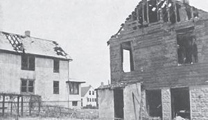 1937 Fox vault fire - Damage to 361 Main, the residence closest to the vaults, with 375 Main in the background