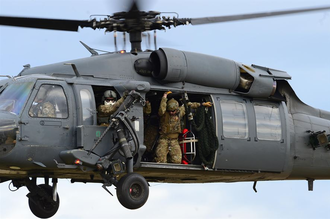 57th Rescue Squadron - Pararescuemen assigned to Royal Air Force Lakenheath's 57th Rescue Squadron prepare to rappel from an HH-60G Pave Hawk during exercise Joint Warrior 15-1