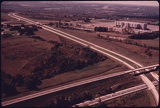Interstate 271 - Aerial view of I-271, exit 12, its crossing of the Ohio Turnpike, and the now-defunct Richfield Coliseum in 1975