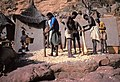 ASC Leiden - W.E.A. van Beek Collection - Dogon agriculture 02 - The young men of the neighborhood ward mash the onions to make balls, Tireli, Mali 1980.jpg