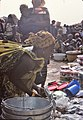 ASC Leiden - W.E.A. van Beek Collection - Dogon markets 12 - Women with children at Sangha market, Mali 1992.jpg