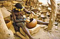ASC Leiden - W.E.A. van Beek Collection - Dogon pottery 01 - Yajagalu finishes the edge of her pottery, Tireli, Mali 1985.jpg