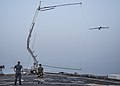 A ScanEagle unmanned aerial vehicle is recovered on the flight deck of the afloat forward staging base USS Ponce (AFSB(I) 15) during International Mine Countermeasures Exercise (IMCMEX) 13 in the U.S. 5th Fleet 130513-N-PX130-098.jpg