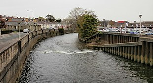 """The <a href=""""http://search.lycos.com/web/?_z=0&q=%22Ogmore%20River%22"""">Ogmore River</a>. To the left of the river is Quarella Road; to the right, a superstore and car park"""