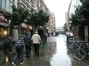 Southampton Street, London - Southampton Street looking north in the rain from the southern Strand end, with Covent Garden Market in the distance.