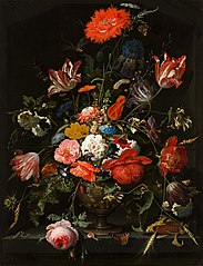 Flowers in a metal vase in a niche