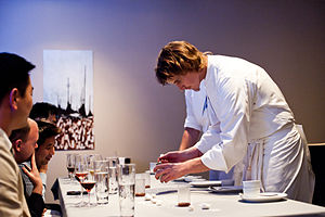 Grant Achatz - Achatz plating a dish for diners at Alinea