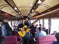 Actuación musical en un viaje del Tren del Recuerdo, entre Santiago y San Antonio, en Chile.jpg