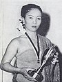 Ade Ticoalu with her Bintang Radio 1953 trophy Film Varia Nov 1953 p14.jpg