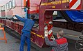 Aeroexpress KISS at Altenrhein, Stadler works, loading onto truck 2.jpg