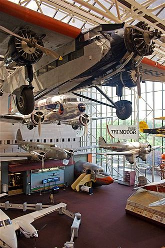 Smithsonian Institution - Aircraft on display at the National Air and Space Museum, including a Ford Trimotor and Douglas DC-3 (top and second from top)