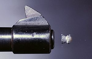 Pellet (air gun) - 4.5mm pellet exiting an air pistol, photographed with a high speed air-gap flash