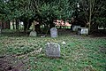 All Saints Church, Berners Roding, Essex churchyard at the east.jpg