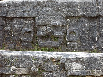 Altun Ha - Stuccoed Jester God face on Structure B4, similar to the face on the Jade Head