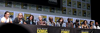 The Walking Dead (TV series) - From left to right: Andrew Lincoln (Rick), Greg Nicotero (producer), Norman Reedus (Daryl), Melissa McBride (Carol), Lennie James (Morgan), Chandler Riggs (Carl), Danai Gurira (Michonne), Jeffrey Dean Morgan (Negan), Lauren Cohan (Maggie), Alanna Masterson (Tara), and Seth Gilliam (Gabriel) on a panel for the series at the San Diego Comic-Con in July 2017
