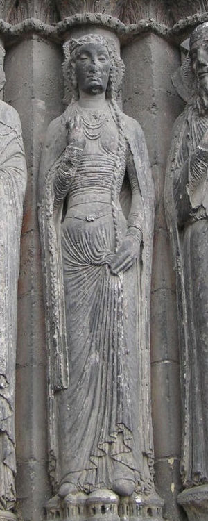 Bliaut - Woman wearing a one-piece bliaut and cloak or mantle, c. 1200, west door of Angers Cathedral.
