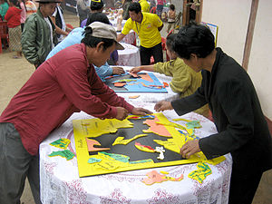 Informal learning - Lao villagers assemble jigsaw maps of Southeast Asia. These maps were made by Big Brother Mouse, a literacy project in Laos. It was the first time any of them had seen a jigsaw puzzle of any sort.