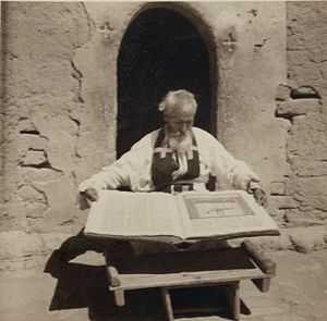Syrian-Assyrians - Assyrian priest with manuscript, Khabur river area, 1939