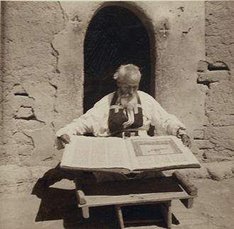 Syrian-Assyrians - Assyrian priest with manuscript, Khabur river area, 1939