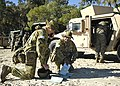 Australian Defence Force officers examining maps during Talisman Sabre with Marines preparing to move out 090715-N-9520G-160.jpg