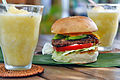 Avocado bacon cheeseburger and pineapple smoothie.jpg