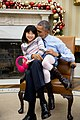 Barack Obama snuggles with his niece Savita Ng.jpg