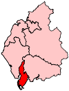 A small constituency in the south of the county. It includes a long but very thin island to the west of the mainland part of the constituency.