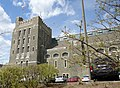 Barton Hall with flag and cars at Cornell University.jpg