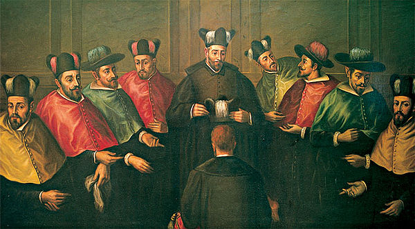 The ancient ceremony of bestowing Complutense's Doctoral biretta. Birrete doctoral.jpg