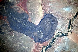 San Francisco volcanic field - Black Point lava flow in the San Francisco volcanic field. Little Colorado River at lower right. Astronaut photo from the International Space Station, 2009.