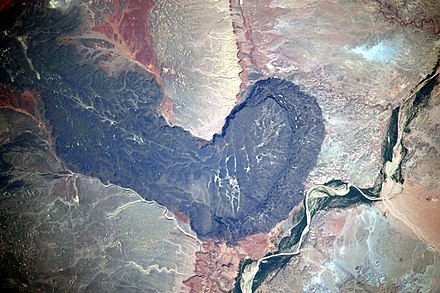 Black Point lava flow in the San Francisco volcanic field. Little Colorado River at lower right. Astronaut photo from the International Space Station, 2009. Black Point Lava Flow, Arizona.jpg