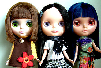 Blythe (doll) - Blythe dolls from around 2006, left to right: Velvet Minuet, Love Mission, Asian Butterfly