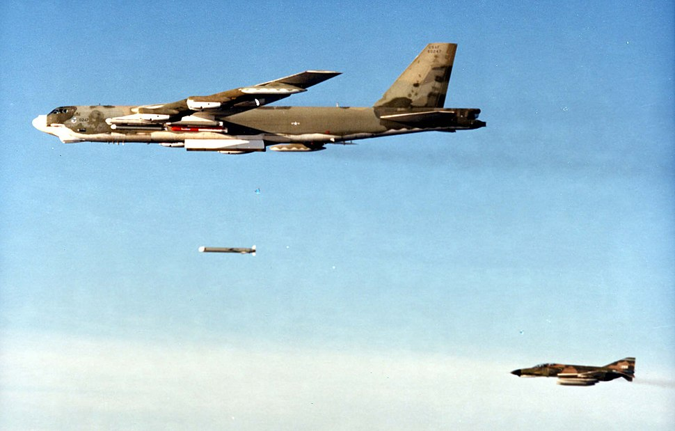 Boeing B-52G in flight dropping SRAM 061026-F-1234S-025