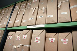 Boxes of documents on repository shelving at The National Archives