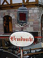 Brandwache (Schild mit Laterne) - Exponat im DFM.JPG