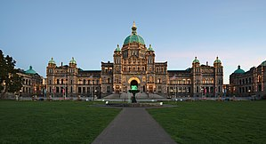 British Columbia Parliament Buildings - The buildings are illuminated at dusk.