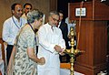 """C.P. Joshi lighting the lamp to inaugurate an International Workshop on """"Achieving Drinking Water Security in Water stressed and Quality Affected Areas"""", in New Delhi on May 25, 2010.jpg"""